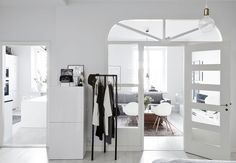 White hallway and glass doors in the Helsinki home of design blogger #lagerma, captured by Riika Kantikoski.