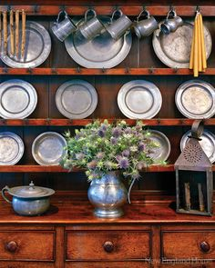An antique Welsh dresser holds a growing pewter collection.