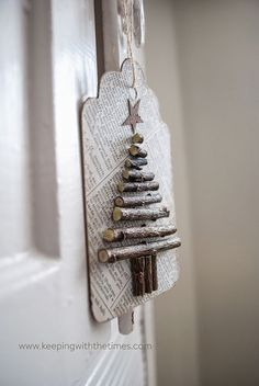 Want to make rustic xmas ornaments for my woodland theme next yr. use old paper, dried twigs, and a bit of ink, to create these cute recycled paper twiggy tags! Great for hanging on the Christmas tree or using for tags. Wooden Christmas Trees, Noel Christmas, Christmas Gift Tags, Rustic Christmas, Winter Christmas, All Things Christmas, Christmas Decorations, Christmas Ornaments, Natural Christmas