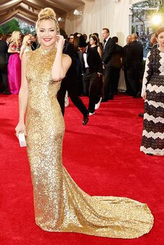 Kate Hudson in a shimmery gold Michael Kors open-back gown at the 2015 Met Gala