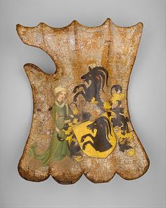 Tournament or Cavalry Shield Date: ca. 1450 Culture: German Medium: Wood, leather, linen, gesso, polychromy, silver Dimensions: H. 22 in. (55.88 cm); W. 16 in. (40.64 cm) Classification: Shields Credit Line: Gift of Mrs. Florence Blumenthal, 1925 Accession Number: 25.26.1