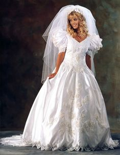 I almost wore a dress like this for my wedding. I did try on a few short-sleeved gowns but wore a long-sleeved gown when I got married.