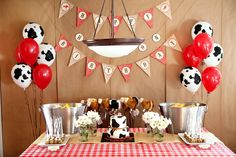 Love cow print ballons with gingham ck tablecloth and bunting