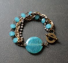 Sky Blue Crackle Agate Bracelet with Rhinestone Chain, Antique Gold chain and Blue Crystal Rondelles. $28.00, via Etsy.