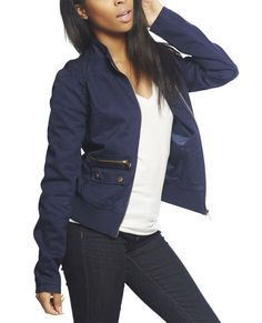 """Keep warm during those chilly nights at the festival with this rad jacket featuring a solid twill body, smocked shoulder detailing, zipper closure and pockets, flap snap front pockets, and a ribbed knit bottom trim.    Model is 5'9"""" and wears a size medium      Shell: 100% Cotton - Lining: 100% Polyester  Machine Wash  Imported"""