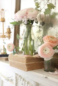 5 minute decorating with Bottles, Books and Blooms on the mantel from French Country Cottage. #blooms #frenchvintage #frenchcountry