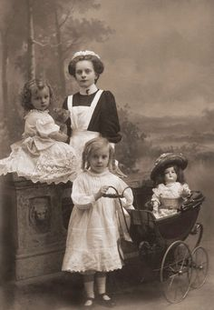 The governess isn't much older than the children !