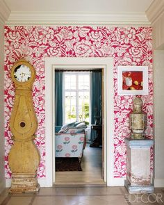Hoteliers Kit and Tim Kemp papered the foyer of their London townhouse in a vivid floral by Bennison.