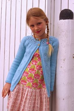 Posy is the first of a series of knits designed to coordinate with the popular Bloom dress. It features the same diamond lace through the body and the yoke as on the dress's body and hemline.This cardigan is knit top-down and seamlessly, beginning with a circular yoke. The body is worked flat and the sleeves in the round with the diamond lace positioned symmetrically across the fronts and the back. The edging is worked as you go to make for minimal finishing.
