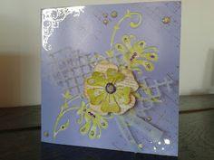 Birthday Card - Geburtstagskarte. Gemacht aus einer fliederfarbenen quadratischen Karte, an drei Ecken mit  Schraffur bestempelt und an 2 Ecken (oben links und unten rechts) mit goldenen Rubbel-Bildern verziert. Aus der Karte wurden zwei Blumengirlanden ausgestanzt und mit kontrastfarbigem Papier ersetzt. Dann noch eine Blume, ein gestanztes Gitter aus Vellum, der Gruß sowie ein wenig Strass und Glitter.        KunstKommtVonMachen - So bastelt der Norden