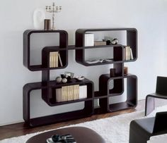 Dedalo Bookcase is designed by Marconato & Zappa and is manufactured by Porada. The Dedalo Bookcase has a modern design and it can be used as a room divider or center against the wall. This uniquely designed bookcase features five round combined squares with round corners, that allows you to store a lot of things, in various ways..