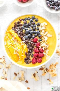 Kick start your day with this delicious and healthy Mango Smoothie Bowl topped with raisins, berries, shredded coconut and sliced almonds! Find the recipe on www.cookwithmanali.com