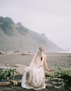 Natural Coastal Wedding Ideas:  beautiful to have some greens and flowers among the driftwood