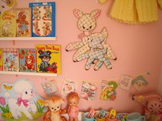 not my kids room, but it is awfully similar, I went with a vintage nursery using my old baby clothes toys and things, and adopted items from the charity shops