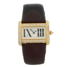 CARTIER - an 18ct yellow gold Tank Divan wrist watch.