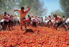 Food fight: 3,000 participate in a 'Tomato War' in Chile. (EPA via msnbc)