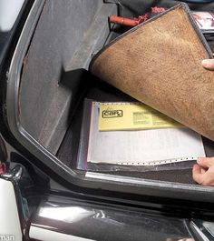 store your car information under a car rug to keep it safe and with the car.