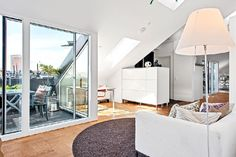 Fresh Scandinavian Attic Apartment With Two Sunny Terraces - http://freshome.com/scandinavian-attic-apartment-with-two-sunny-terraces/