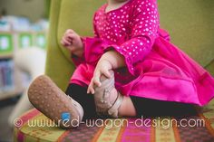bright colors.  sweet toes.  happy toddler.  #lifestyle #photography #toddler #redwagondesign  www.red-wagon-design.com