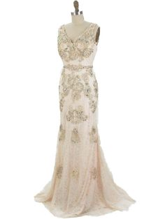 <p>30s style lace gown for an Old Hollywood or Art Deco wedding or formal social event. Curve hugging fit, beaded appliques and matching capelet create a romantic Jazz Era look! Pair with gold metallic T strap heels, beaded purse, do your hair in soft finger waves and channel your inner Carole Lombard!</p> <p>DETAILS;</p> <p>•Ivory lace over palest champagne jersey knit. Gives dress the look of an antique wedding gown. Darker champagne color appliques adorn the dress and matching lace c...