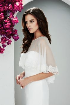 strapless gown with sheer, lace-edged cape