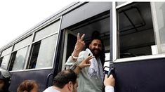 PML-N supporters, who were arrested after holding a rally to obstruct the arrest of Capt (retd) Safdar, gesture from a prison van after the. Nawaz Sharif, Geo Tv, Geo News, Prison, Pakistan, The 100, Couple Photos, Couples, Couple Shots