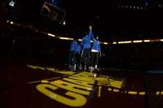 Kevin Durant of the Golden State Warriors high fives his teammates before the game against the Philadelphia 76ers on November 11 2017 at ORACLE Arena...