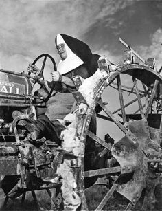 Lemont, Illinois. August 4, 1942. Sister Mary Othelia drives one of the Mount Asissi Convent's tractors across the fields where the nuns do all of the planting and harvesting on the 100 acre farm.