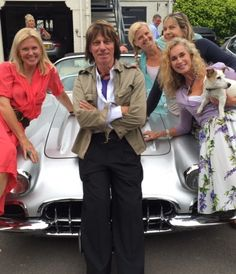 Legendary rock guitarist Jeff Beck sitting on his '59 Corvette  restomod