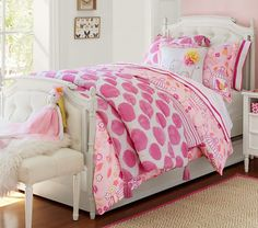 Make their dreams extra sweet with a tufted wood bed that looks straight out of a fairytale.