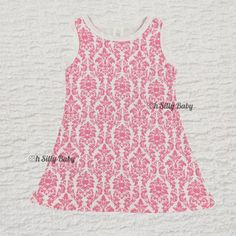 Pink Damask Dress 2/3T. This whimsical pretty Pink Damask Print Dress is constructed from durable Interlock Knit fabric. Made from 100% cotton, the damask dress can be paired with leg warmers or leggings.