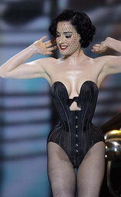 Such a great corset on Dita! Almost certain it's by Mr. Pearl.