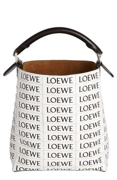 Free shipping and returns on Loewe Logo Calfskin Leather Tote at Nordstrom.com. Pre-order this style today! Add to Shopping Bag to view approximate ship date. You'll be charged only when your item ships.Individually sewn tiered logos lend graphic impact to a spacious tote fashioned from smooth calfskin leather. A rolled top handle and detachable strap add carrying options to the style, while a deep, suede-lined interior complete with a tethered zip pouch easily accommodates all your essen...