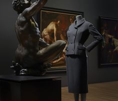 "Installation view of ""Catwalk"" at the Rijksmuseum, featuring a 1952 dress with matching jacket by Christian Dior.<br>Photo: Erwin Olaf, Courtesy Rijksmuseum."