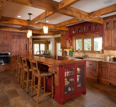 Rustic kitchen using Knotty Alder wood. Love the red.