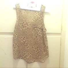 Topshop Petite Leopard Tank Top Topshop Petite US size 8 leopard print sheer tank top with one breast pocket that has a bronze zipper closure detail. No flaws or signs of wear. Topshop PETITE Tops Tank Tops