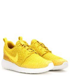 Nike Roshe One Flyknit yellow sneakers