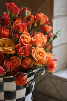 orange roses = desire, excitement, enthusiasm! / > beautiful arrangement! looks like a Mckenzie Childs bucket