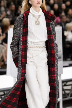 Chanel jackets, pants, skirts and jumpsuits of tweed woven with silver metallic thread and embellished with pearls paired with glittery boots.