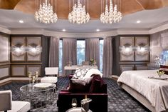 Transitional Master Bedroom with Hardwood floors, Crown molding, interior wallpaper, Cathedral ceiling, Chandelier, Carpet