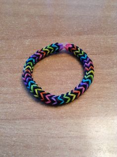 Love the black in between the colors - Rainbow loom three pin fishtail
