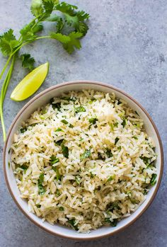 BEST cilantro lime rice, no kidding! Better than Chipotle's. EASY to make. Perfect with Mexican and Asian food, great in burritos. On SimplyRecipes.com #Cilantro #MexicanFood #Rice #RicePilaf