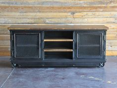 72 W x 20D x 30T Stainless steel or reclaimed boxcar oak top available Two Shelves Heavy wire mesh doors with 1/2 round accents x2 on both ends w/grommet holes Steel finish: Black patina or light rust patina Skirt below with 1/2 round steel accents 5 factory casters