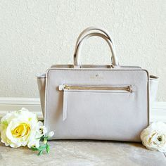 """Kate Spade North Ct. Corraline Satchel Clocktower A Nordstrom exclusive! Gorgeous, NWT Kate Spade North Court Corraline structured satchel in """"Clocktower,"""" a beautiful shade of neutral pale gray pebbled- grain leather. 14K gold- plated hardware, a zippered top closure, smartphone pockets, detachable shoulder strap & signature print lining. Approx. 12"""" in length, 8.5"""" in height & 5"""" wide. Limited amount in circulation, sold out in stores & online! Ships w/ Kate Spade dust bag. kate spade Bags…"""