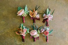 Southwestern inspired wedding boutonnieres wrapped in wine colored ribbons.