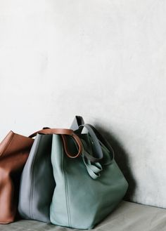 I like that soft aqua one! I think one of these tote-like purses in soft leather might be a good pick for you. Baggu in Brooklyn makes some (and a lot of stores carry them, plus you can order online).