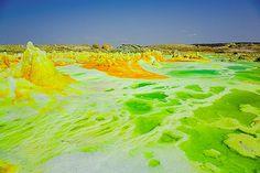 Tom Pfeiffer Green acid salt ponds - Dallol volcano, Danakil desert (Ethiopia) Bizarre green and yellow acid salt ponds and miniature geysers at at Dallol volcano, Ethiopia.