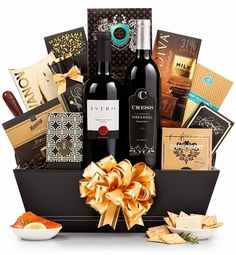 One of our elegant wine gift baskets, the Wine and Gourmet Extravagance ($113.99) is an exquisite gift to give. Packed in a reusable container, this gift has two bottles of wine and an assortment of gourmet treats.  Perfect to send to a friend, family member, or a client, this impressive gift is gift-able for a number of occasions.