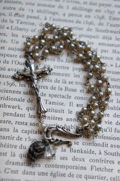 Vintage assemblage bracelet glass pearls religious medal cross bracelet sideways cross assemblage jewelry - by French Feather Designs...I am Soooo on love with this! Gorgeous! !