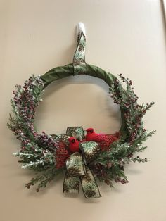 Handmade wreath with green ribbon, pine cone ribbon, red berries and Cardinals. Woodland Christmas, Red Christmas, Christmas Themes, Christmas Decorations, Christmas Ornaments, Holiday Decor, Winter Wreaths, Xmas Wreaths, Scented Pinecones